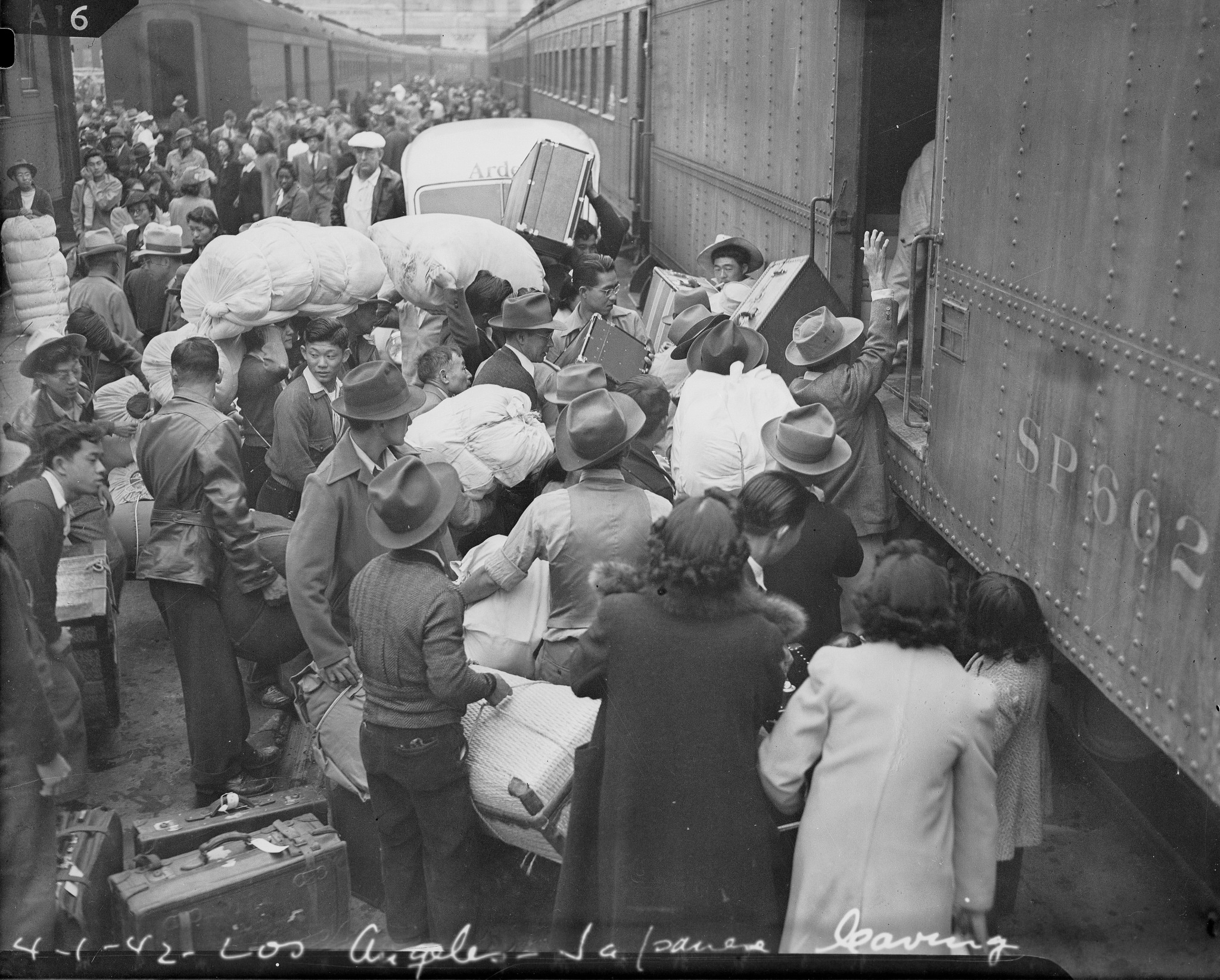 Boarding trains for Manzanar Relocation Center