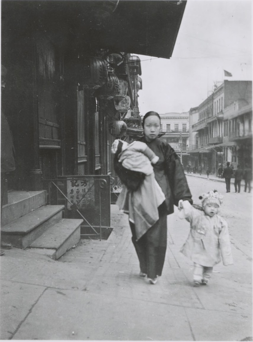 Mother Walking with two children